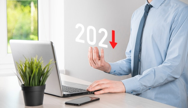 Plan business negative growth in year 2021 concept. businessman plan and increase of negative indicators in his business, decline down business concepts