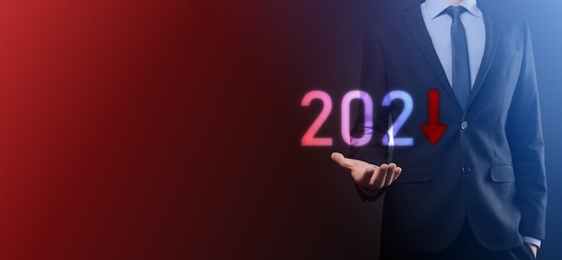 Plan business negative growth in year 2021 concept. businessman plan and increase of negative