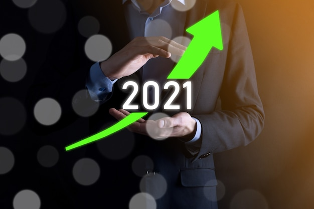 Планируйте положительный рост бизнеса в концепции 2021 года. план бизнесмена и увеличение положительных показателей в своем бизнесе, взросление бизнес-концепций.