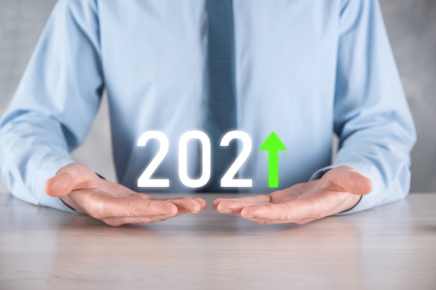 Plan business positive growth in year 2021 concept. businessman plan and increase of positive indicators in his business, growing up business concepts.
