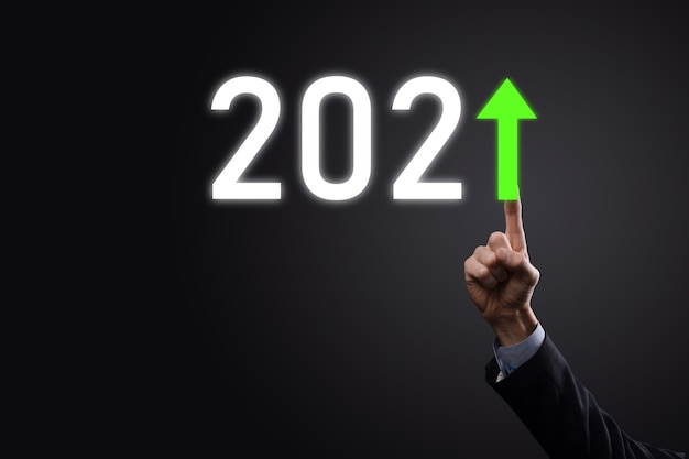 Plan business positive growth in year 2021 concept. businessman plan and increase of positive indicators