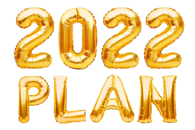 Plan phrase made of golden inflatable balloons isolated on white new year resolution goal list change and determination concept helium balloons foil letters and numbers celebration decoration