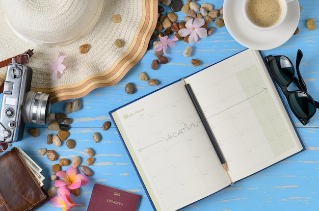 Plan to travel on calendar book with accessories for travel