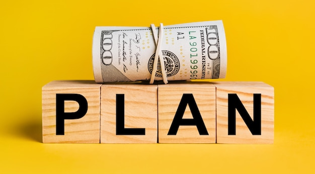 Plan with money on a yellow background. the concept of business, finance, credit, income, savings, investments, exchange, tax