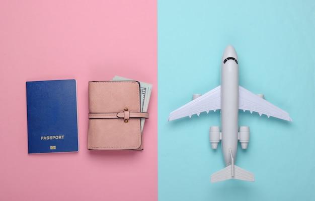 Plane figurine, passport, wallet. rest, vacation and tourism or emigration.