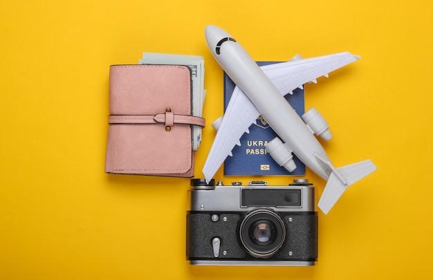 Plane figurine, passport, wallet with dollars