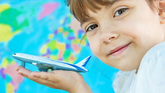 The plane is in the hands of the child. selective focus.