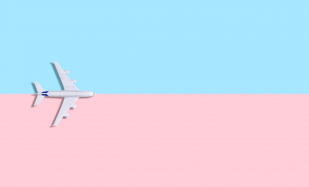 Plane on a pastel  blue-pink background.