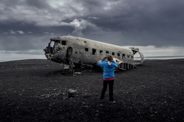 Plane wreckage in black sand beach in iceland