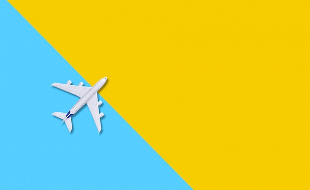 Plane on a yellow  background.