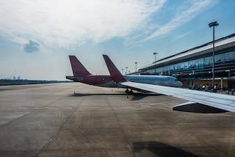 Planes on runway in modern airport
