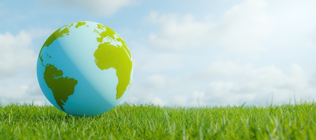 Planet earth on grass with blurred cloudy sky. environment concept. 3d rendering