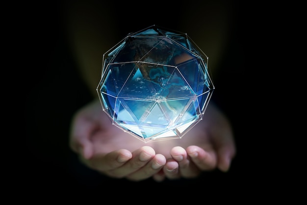 The planet earth in a human hand