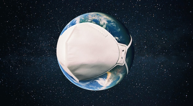 The planet earth is wearing a respirator in the space. concept of quarantine, protection from viruses and pandemic. elements of this image furnished by nasa