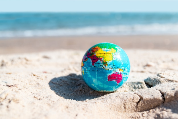 Planet earth made on sand background. save the world, creative, environment pollution world earth day concept.
