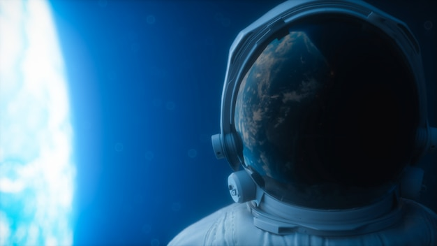 The planet earth reflects in a spacesuit helmet