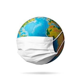 전염병 확산 의학 및 건강 관리의 얼굴 마스크 개념을 착용하는 행성 지구
