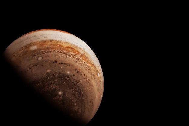 Планета юпитер на темном фоне. элементы этого изображения предоставлены наса. фото высокого качества