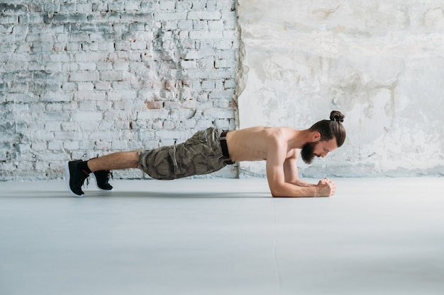 Plank hold. man exercising. fitness training and gym workout. sport lifestyle