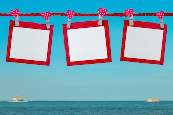 Plank paper note on the beach with sky background