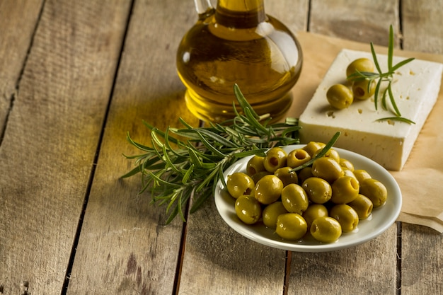 Planks with olives and olive oil