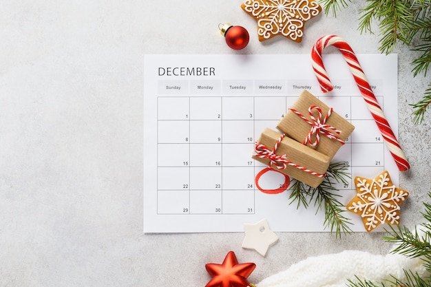 Planner page with christmas gift boxes, cookies and decoration