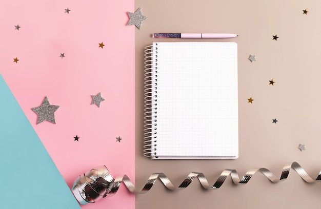 Planner with blank list and pen above triple colored backgroundconcept of the to do list or aims