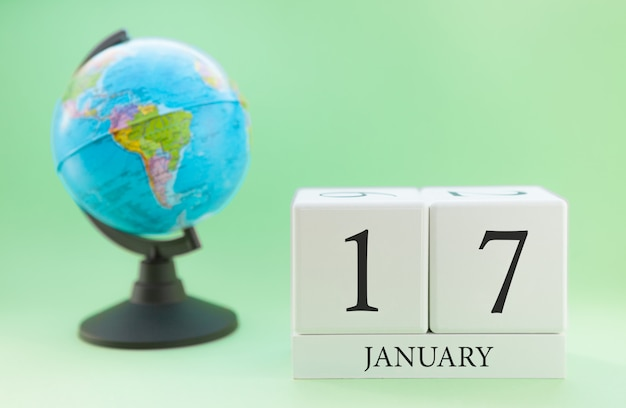 Planner wooden cube with numbers, 17 day of the month of january, winter