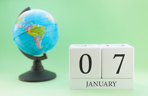 Planner wooden cube with numbers, 7 day of the month of january, winter