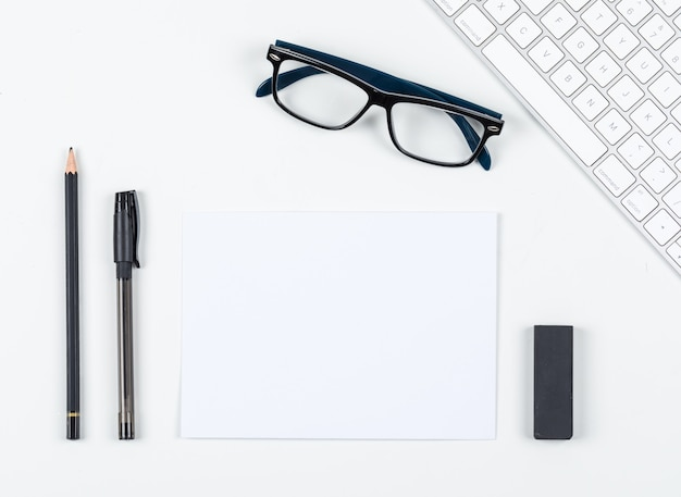 Planning concept with pen, pencil, eraser, eyeglasses, paper, keyboard on white background space for text, top view. horizontal image
