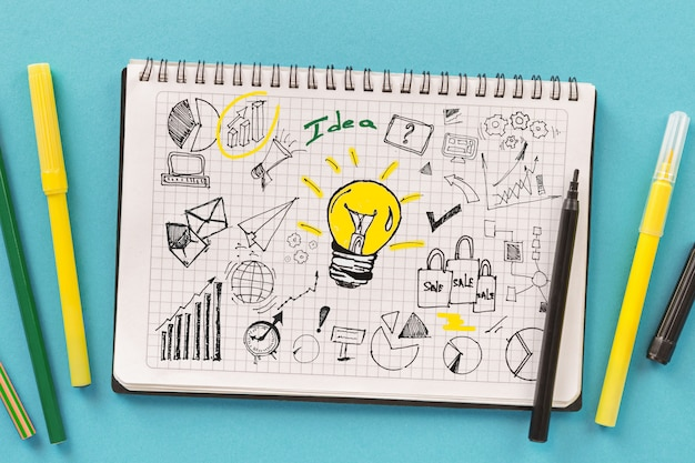 Planning new business or startup strategy development. notebook with creative drawings