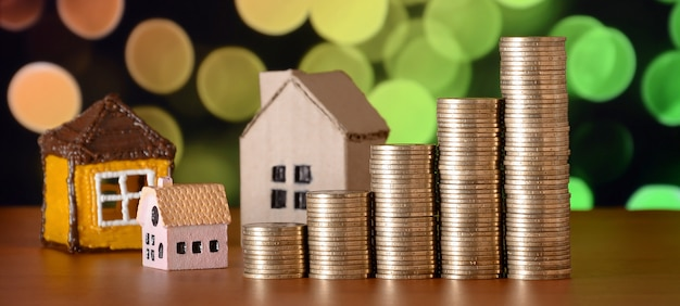 Planning savings money of coins to buy a home concept