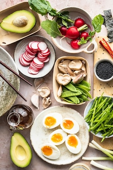 Plant-based meal with egg and vegetables flat lay photography