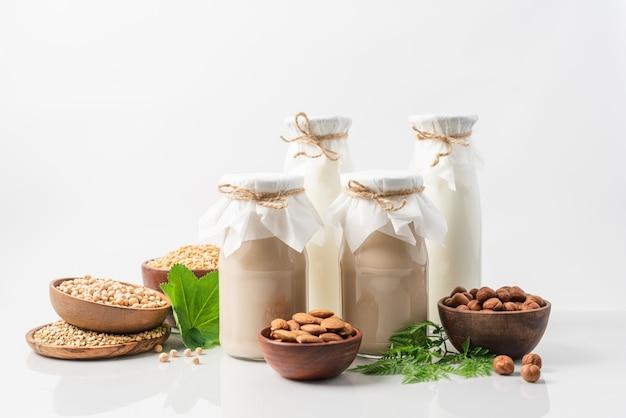 Plant based milk in glass bottles on white background