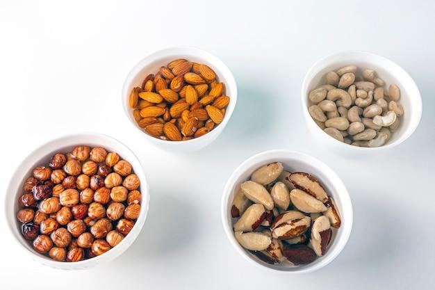Plant based organic veggies on white bowls and white background