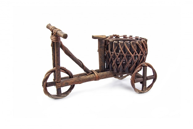 Plant pot made from dark brown wood in bicycle shaped vintage style for decoration garden and home isolated