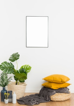 Plants with empty frame and cushions