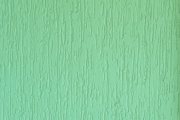 Plastered surface of a green grooved wall. in brazil known as grafiato.
