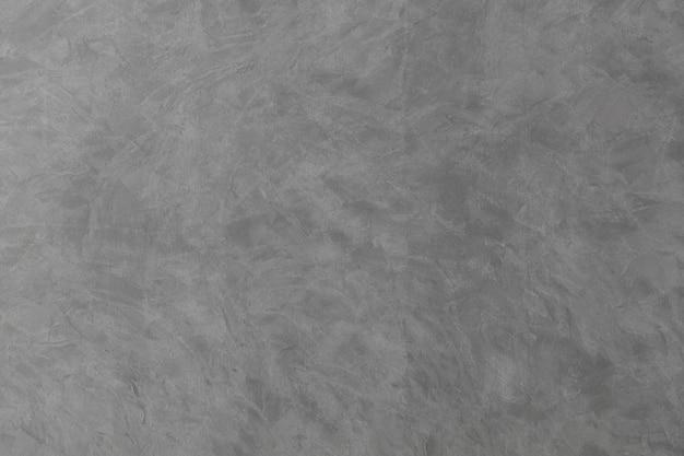 セメント色の背景で壁を漆喰