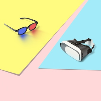 영화 및 가상 현실 vr 안경을 복사 공간이있는 삼색 파스텔 배경에 컴퓨터 게임을하기위한 플라스틱 3d 스테레오 안경.