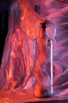 Plastic bag colour concept with bottle