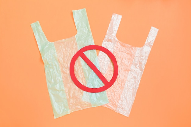 Plastic bag on light with a red forbidden sign on top.