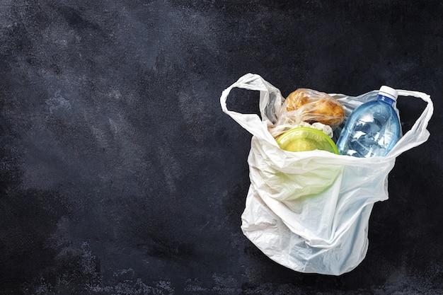 Plastic bag with food on black