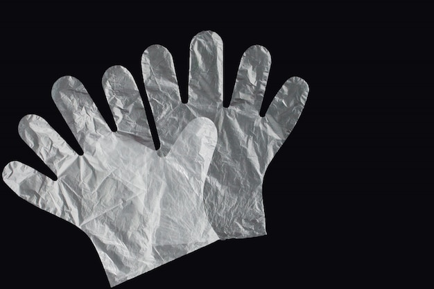 Plastic bag with handles, gloves.