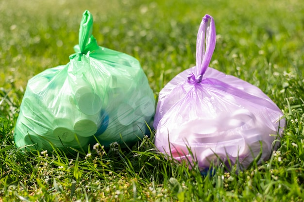 Plastic bags with trash on grass