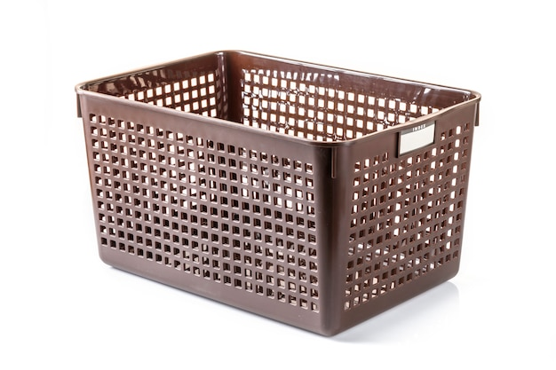 Plastic basket on a white