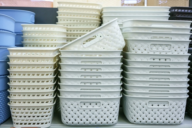 Plastic baskets on the shelf in the store
