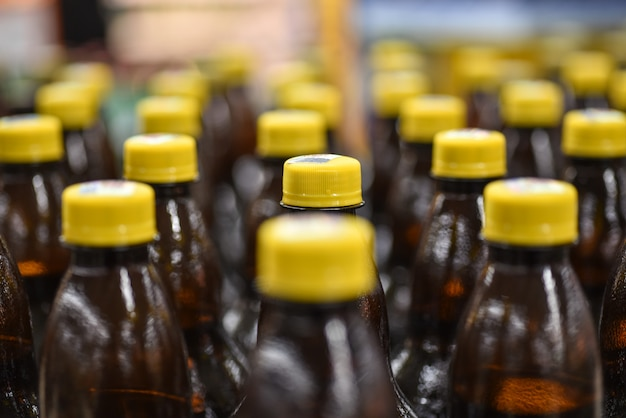 Plastic beer bottles on factory conveyor