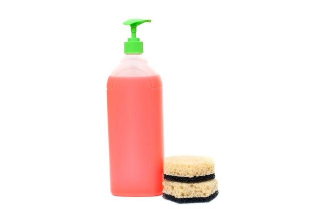 Plastic bottle of detergent and sponge on white