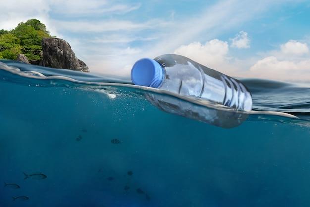 Plastic bottle floating in ocean pollution in open sea
